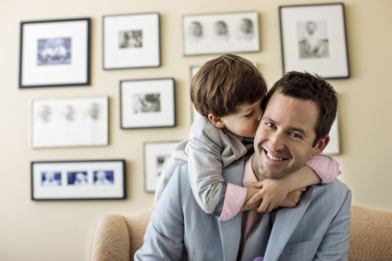 Son Hugging and Kissing His Father in Suit